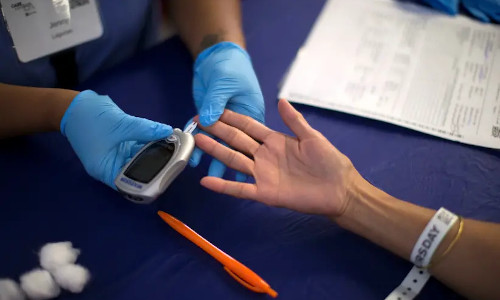 A person receives a test for diabetes during Care Harbor LA free medical clinic